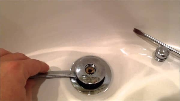 How to remove stopper from bathroom sink